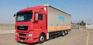 MAN TGX 26.440 tilt truck
